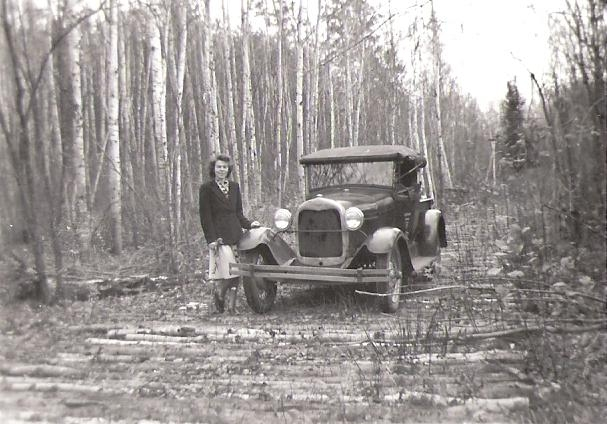 Margaret with car in woods