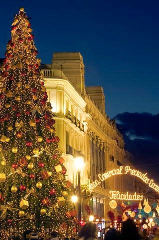 A Christmas tree greets revelers at the Puerta del Sol in Madrid.