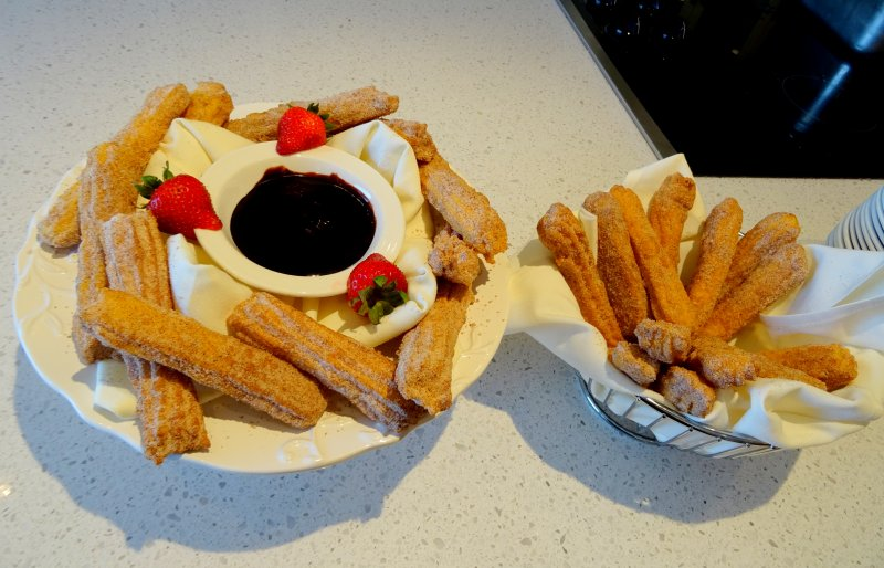 Absolutely the most delicious Brazillian churros with strawberries and chocolate dip