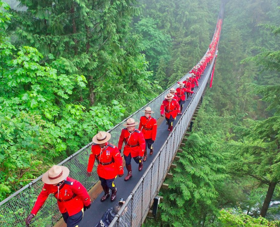 RCMP leaving bridge after posing for historic photo 8 June 2017 Google image from https://pbs.twimg.com/media/DDqmTe1WAAAXar_.jpg