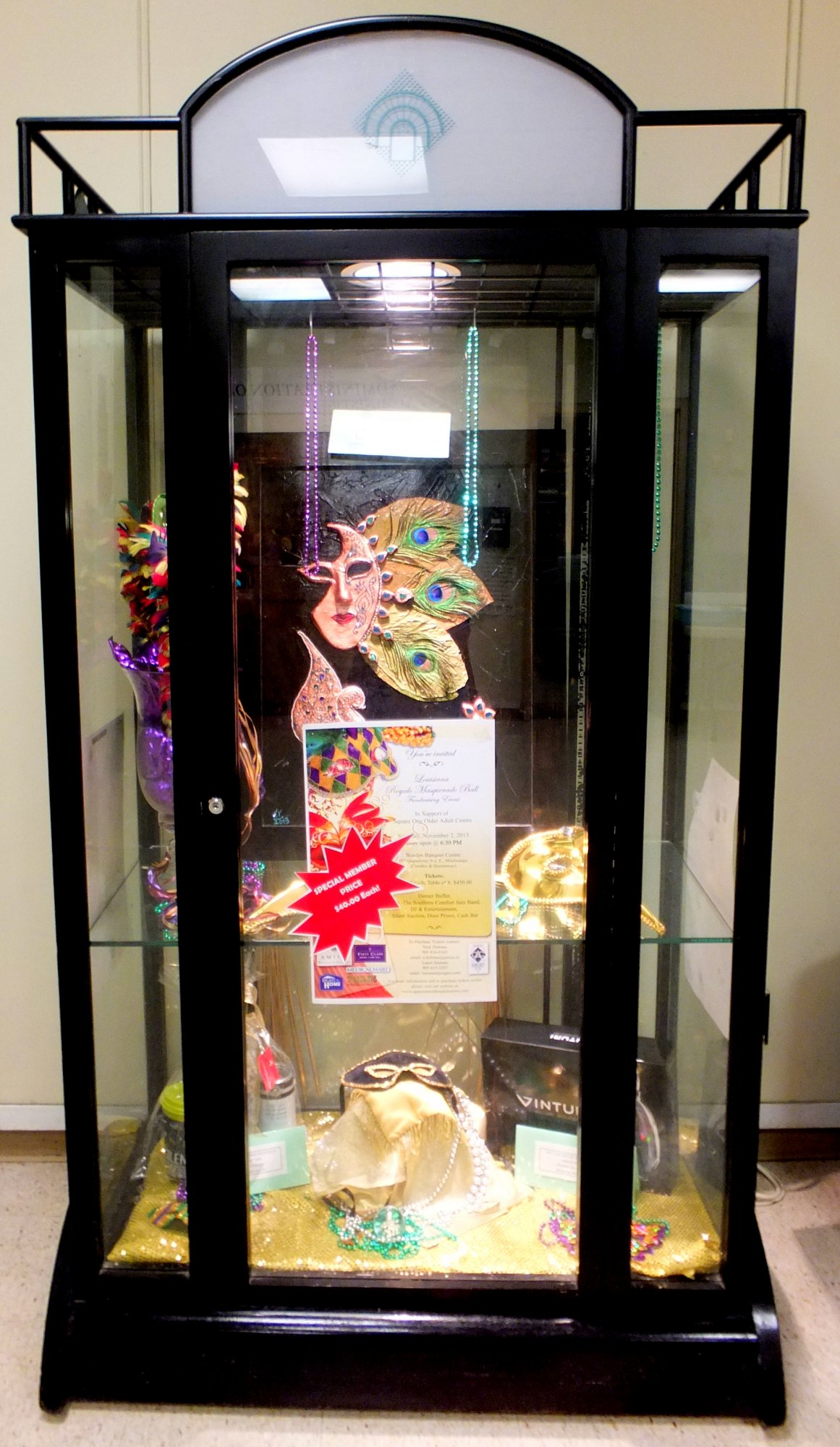 Masquerade Display Case at Older Adult Centre Lobby