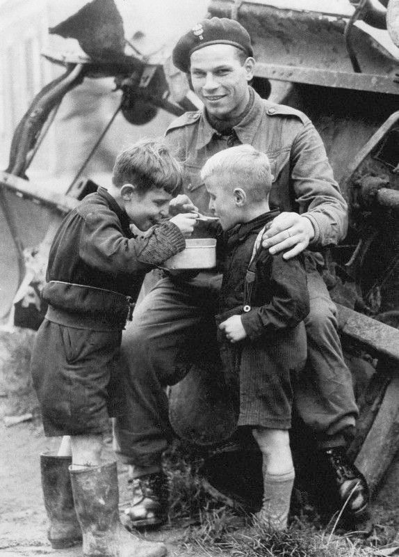 Soldier gives food to two hungy boys, Liberation of Netherlands 1945 Google image from https://s-media-cache-ak0.pinimg.com/736x/f3/d1/4c/f3d14c159914a2f2239cd90694de8cc8--canadian-soldiers-american-soldiers.jpg