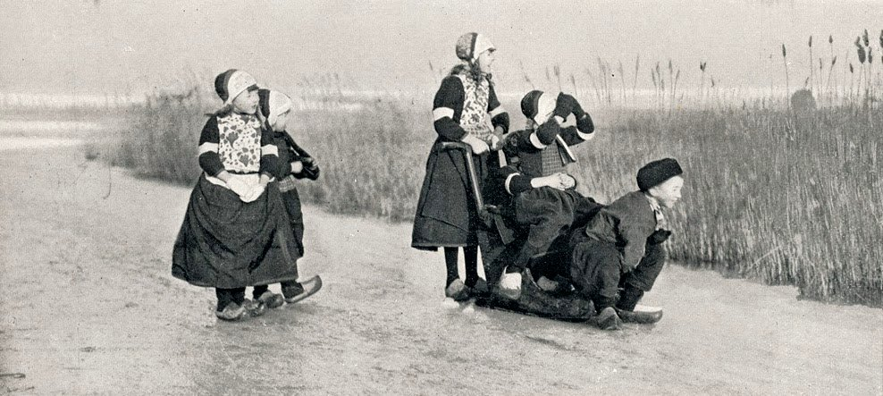Chidren sliding on ice in the Netherlands, circa 1900-1920 Google image from http://www.vintag.es/2014/09/vintage-photographs-of-netherlands-ca.html