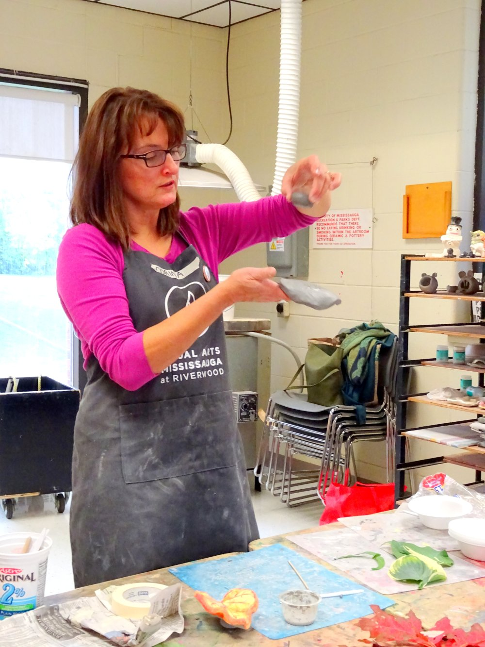 Art Instructor Corina teaching seniors how to make clay leaves photo by I Lee, October 6, 2015
