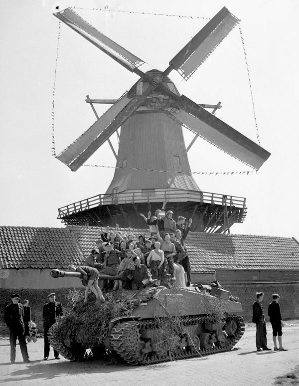 Dutch children riding on a Sherman tank of Lord Strathcona's Horse (Royal Canadians), Harderwijk, Netherlands, 19 April 1945 Google image from http://41622745.weebly.com/uploads/2/5/6/6/25668154/5970794_orig.jpg