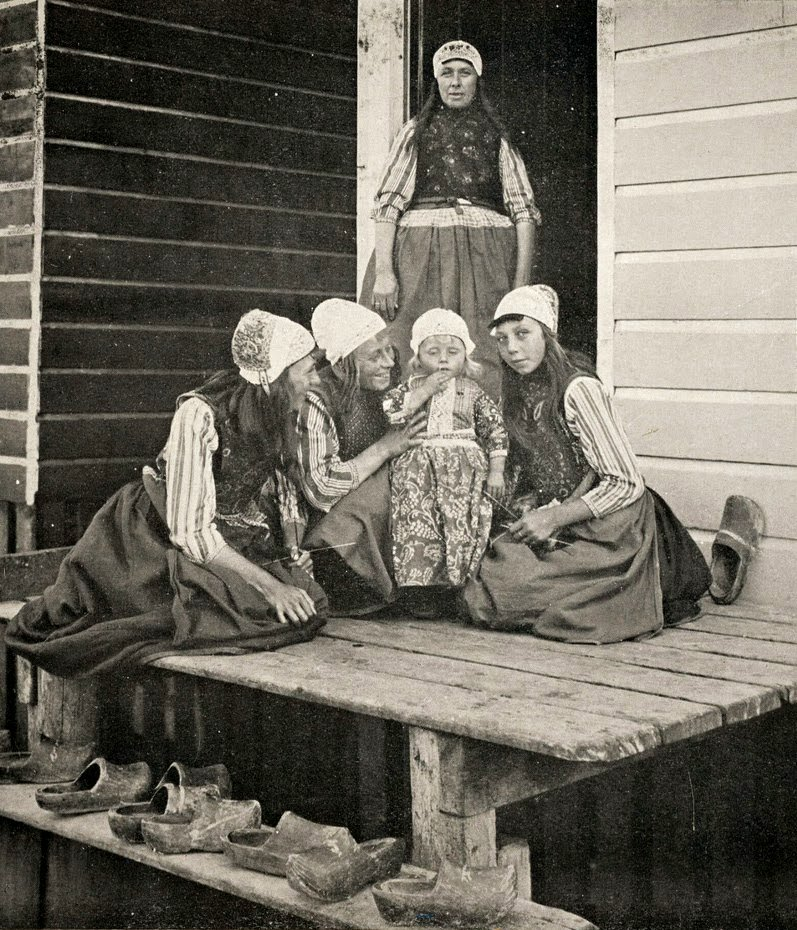 Dutch Family Leaving Wooden Shoes Outdoors, circa 1900-1920 Google image from http://2.bp.blogspot.com/-bXC3AyYSPaw/VCa95u2pw5I/AAAAAAAA-pw/JJGMin28fBg/s1600/Netherlands%2C%2Bca.%2B1900-1920%2B(3).jpg