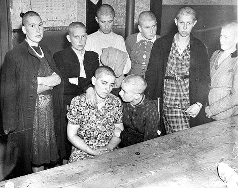 Women's heads shaved for public humiliation. Photo credit: Netherlands National Archives, image from http://fcit.usf.edu/holocaust/GALL31R/81875.htm