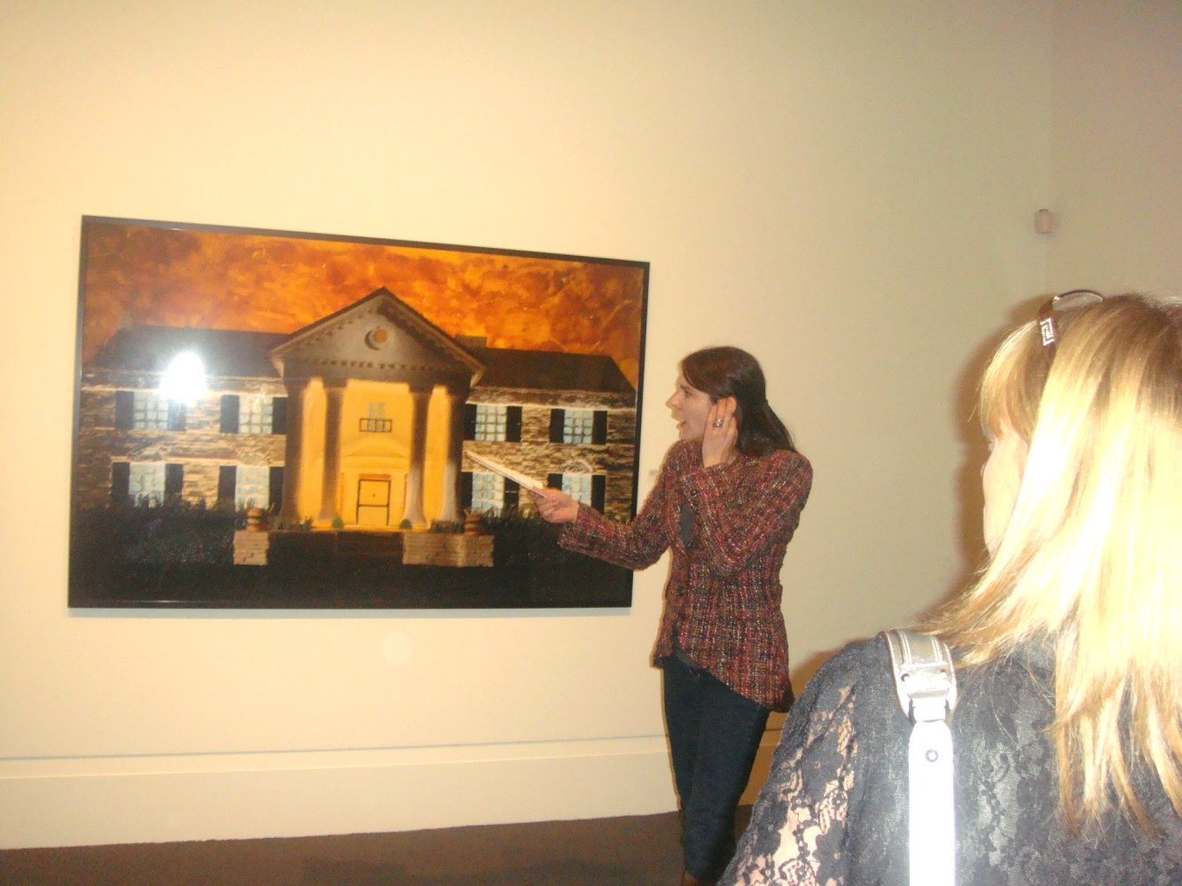 Curator Tara Marshall explaining art work GRACELAND