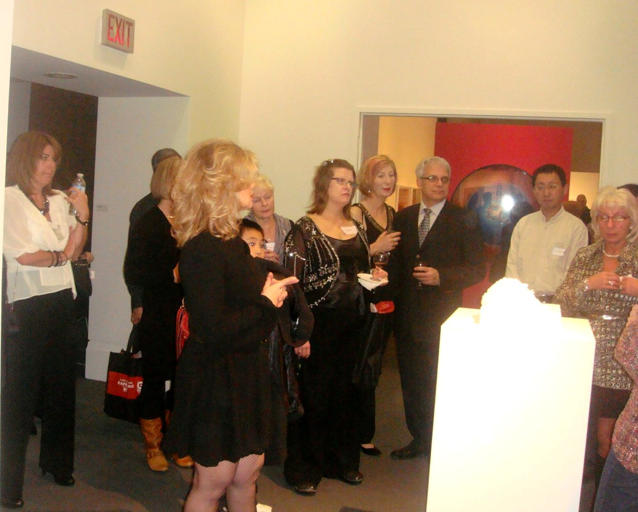 Guests and curator looking at sculpture by Fiona Kinsella
