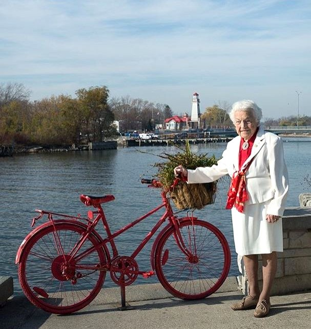 Hazel McCallion beside Red Bike at Port Credit Harbour Marina