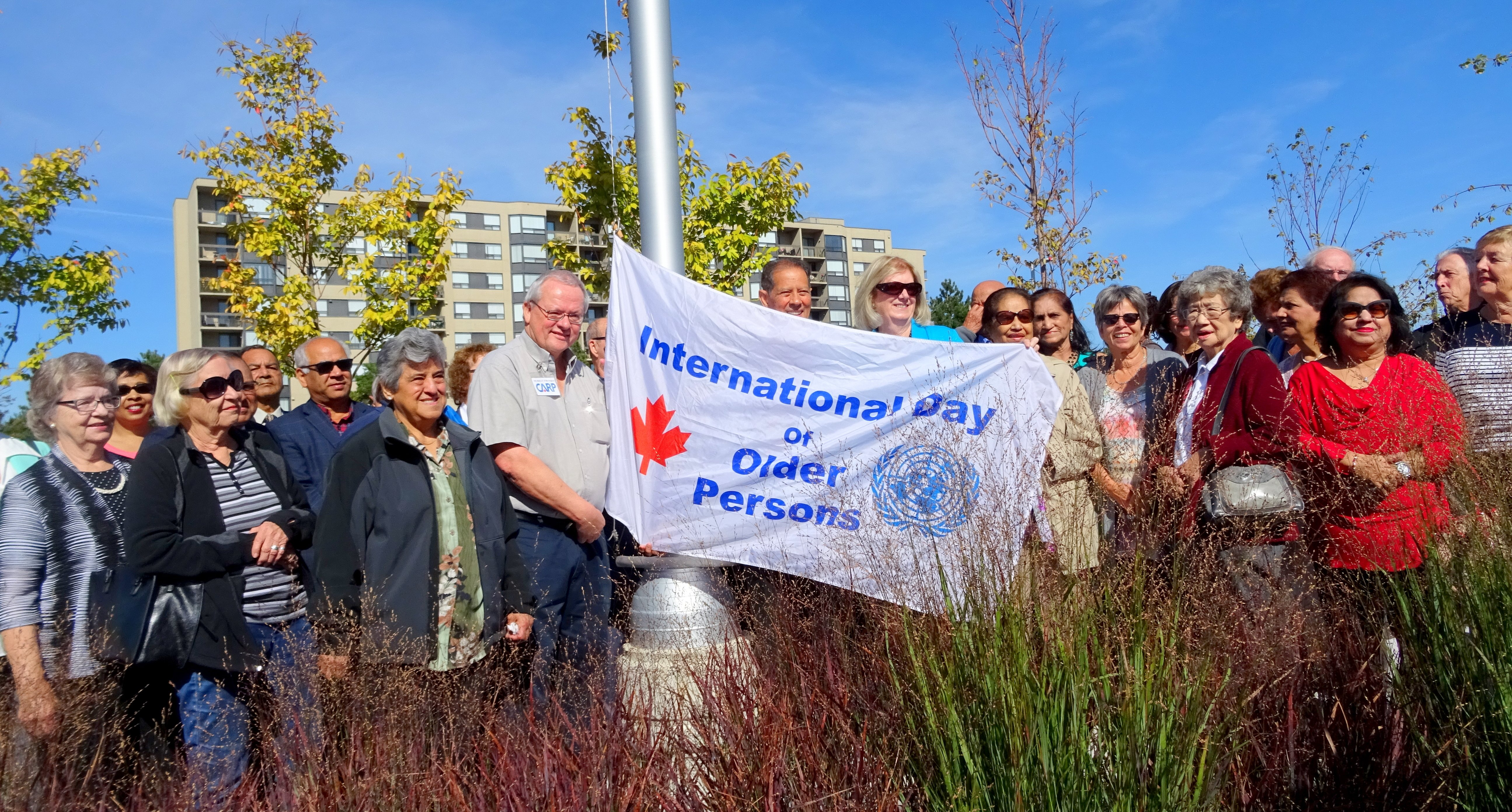 Murray Etherington, Bernard Jordaan, Pat Saito and others at International Day of Older Persons flag raising ceremony, Meadowvale CC, 2 Oct 2017 Photo by I Lee