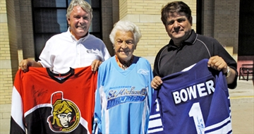 Car dealership owner Laurie Williamson, Mayor Hazel McCallion and Ron Lenyk, Publisher of The Mississauuga News, show off some of the items that will be up for auction at the golf tournament. Photo credits: Mississauga News