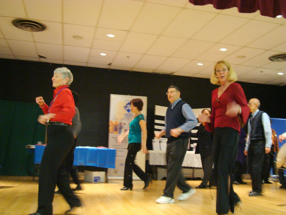 Merilyn leading Line Dance group on stage, Square One Older Adult Centre 26 March 2010