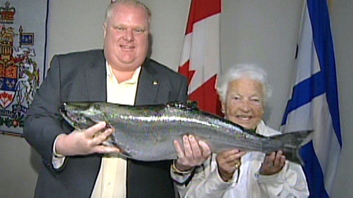 Mayor Rob Ford given 18lb Salmon caught by Mayor Hazel McCallion, Aug 2011 Google image from https://i.cbc.ca/1.1947216.1381383104!/httpImage/image.jpg_gen/derivatives/16x9_1180/hi-852-ford-fish.jpg