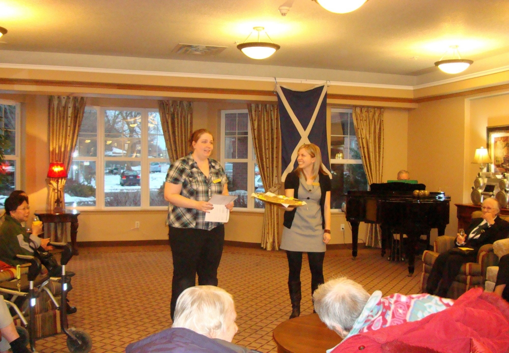 Regency Activities Coordinator Taylor Surman and Regency Community Relations Manager Sara Gregorash welcome everyone to Robbie Burns Celebration at Regency Retirement Residence