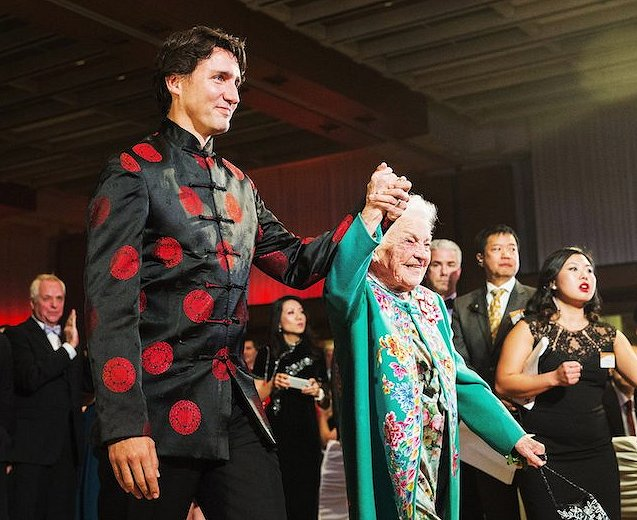 Justin Trudeau with Hazel McCallion on his arm Google image from http://www.macleans.ca/wp-content/uploads/2016/02/TRUDEAU-story.jpg
