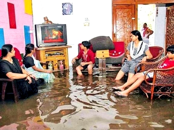Family in India watching TV in flooded room Google image from http://thechive.com/2009/05/27/the-funny-side-of-floods-32-photos/funny-flood-gallery-27/ Author: Leo 25 May 2009