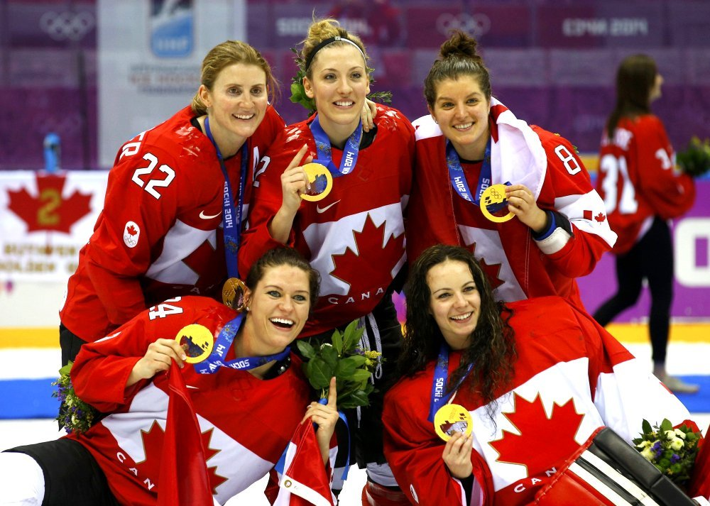 FEB 20, 2014 Canada's Wickenheiser, Agosta-Marciano, Fortino, Spooner and goalie Szabados pose with their gold medals after their team defeated Team USA in overtime in the women's gold medal ice hockey game at the 2014 Sochi Winter Olympics. Google image from http://darkroom.baltimoresun.com/wp-content/uploads/2014/02/REU-OLYMPICS-ICEHOCKEY__0016.jpg