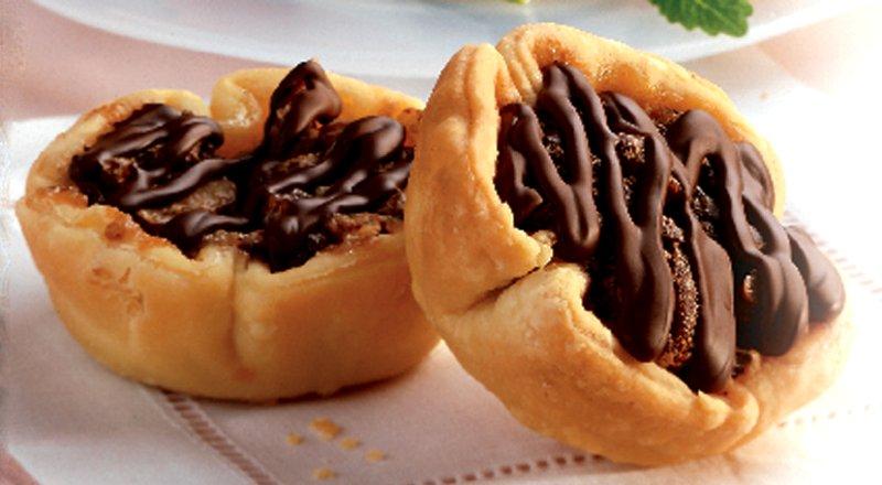 Chocolate Pecan Tarts Google image from https://www.dairygoodness.ca/recipes/chocolate-pecan-tarts