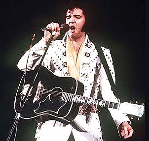 Elvis Presley with guitar Google image from http://i.telegraph.co.uk/multimedia/archive/01486/elvis_1486800c.jpg