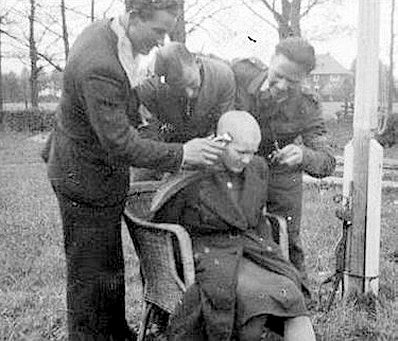 Three men shaving a Moffenmeid's head bald Google image from http://jagahost.proboards.com/thread/16496/remembrance-dead