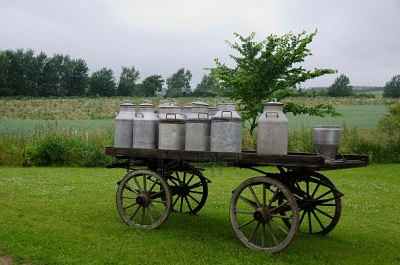 Traditional milk cans on a wooden horse and cart Google image from http://us.123rf.com/400wm/400/400/arrxxx/arrxxx1108/arrxxx110800043/10320293-old-traditional-milk-cans-on-a-wooden-horse-and-cart.jpg