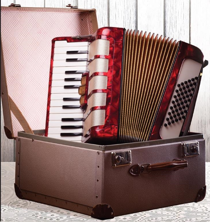 Accordion in a Case image from Robert Speck Heritage Celebration March 30, 2014 Advertisement