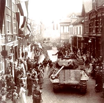 On 17 April, 1945, the Canadian lead tanks roll into Apeldoorn, loudly cheered by relieved residents - image from http://www.bouwman.com/netherlands/Liberation.html